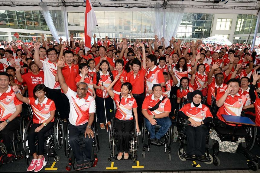 Deputy Prime Minister Teo Chee Hean; Minister for Culture, Community and Youth, Ms Grace Fu; and Singapore chef-de-mission for the 8th Asean Para Games, Mr Raja Singh (front row, third from left), joining Singapore athletes and officials at the One T