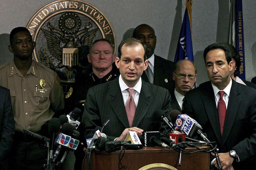 A 2006 file photo shows then US Attorney R. Alexander Acosta (centre) speaking during a press conference.