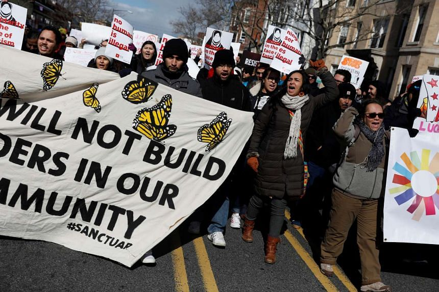 """Demonstrators march during the """"Day Without Immigrants"""" protest in Washington DC, Feb 16, 2017."""