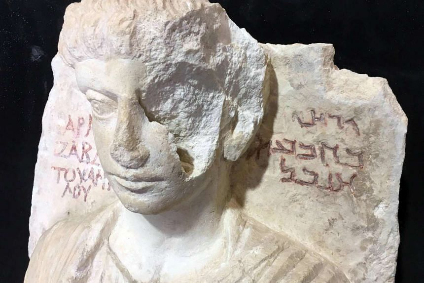 A limestone male bust dated between the 2nd and the 3rd century A.D. that was damaged during the Islamic State occupation of the Syrian city of Palmyra.