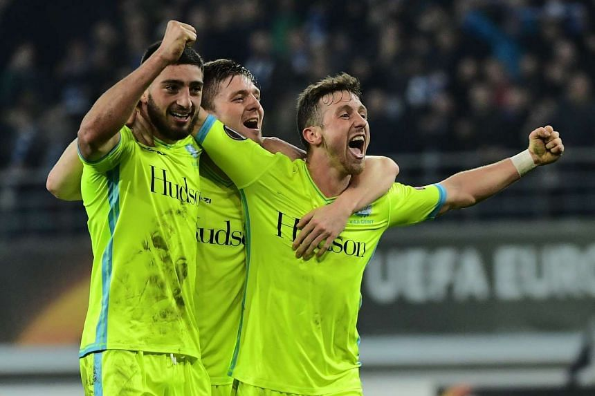 Gent's Brecht Dejaegere (right), Samuel Gigot (left) and Thomas Foket celebrate after winning.
