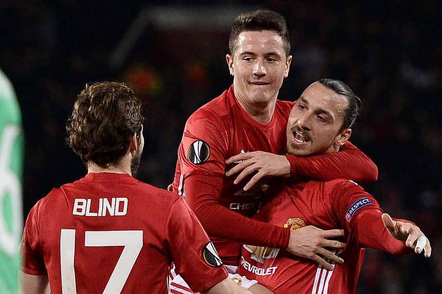 Ibrahimovic (right) celebrates scoring his team's first goal from a freekick.