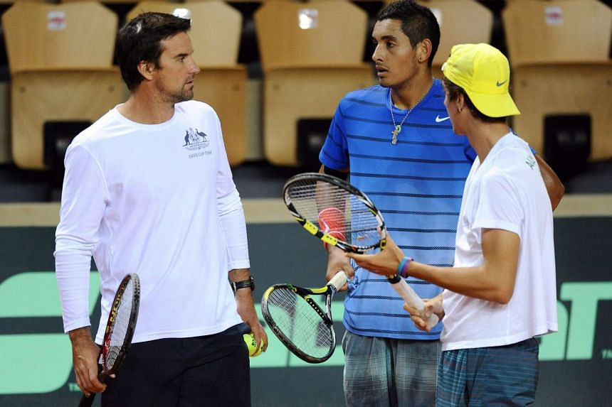 Pat Rafter (left) talks with Thanasi Kokkinakis (right) and Nick Kyrgios during a training session two days before the Davis Cup at The Vendespace in Mouilleron-le-Captif, western France in 2014.