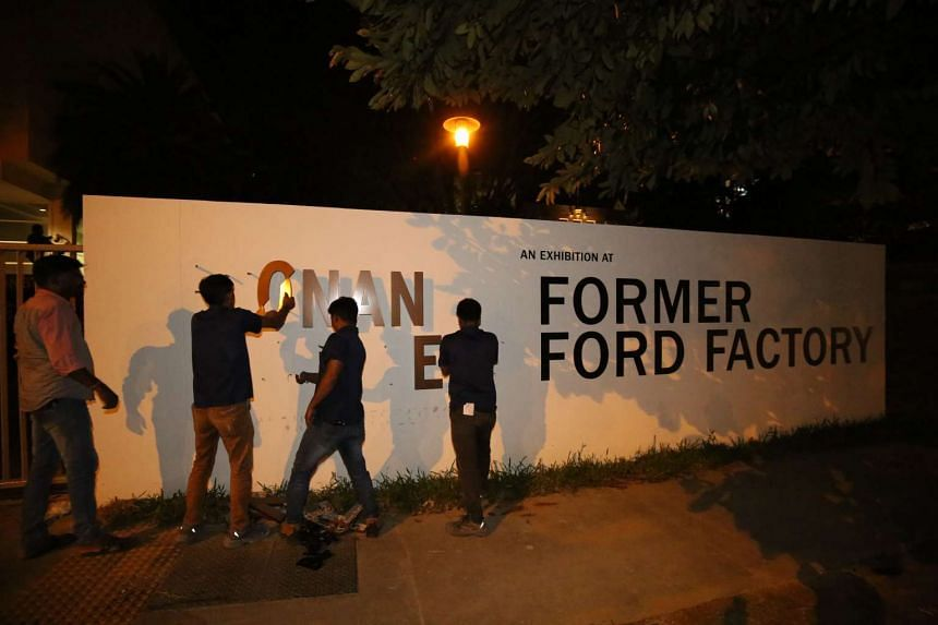 Workers remove the Syonan Gallery signage from the Former Ford Factory on Feb 17, 2017.