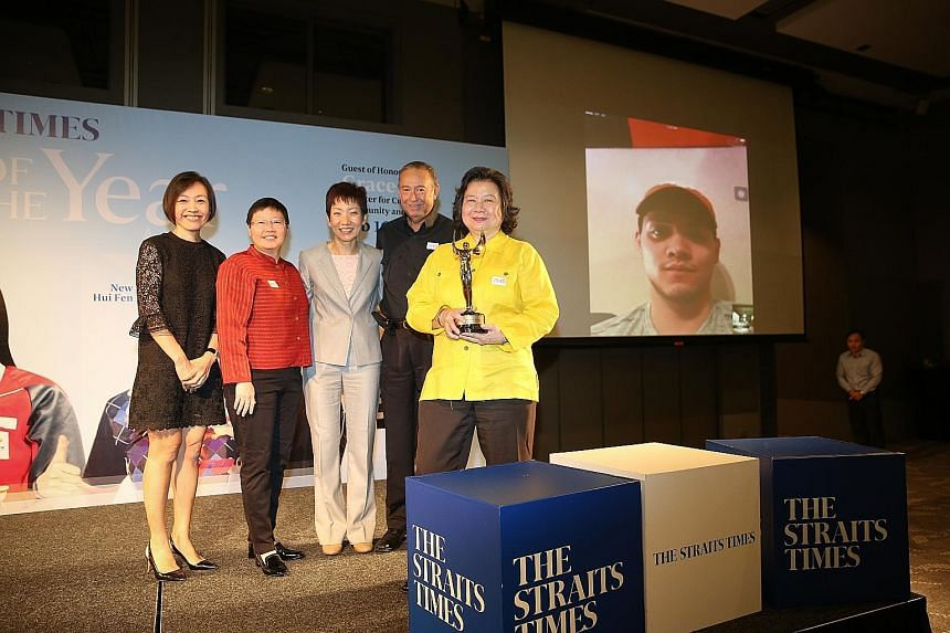 Joseph Schooling (on projection screen) joined yesterday's ceremony via a live Skype feed. Celebrating his win on stage yesterday were (from left) general manager of F&N Foods Singapore Jennifer See; Straits Times sports editor Lee Yulin; Minister fo