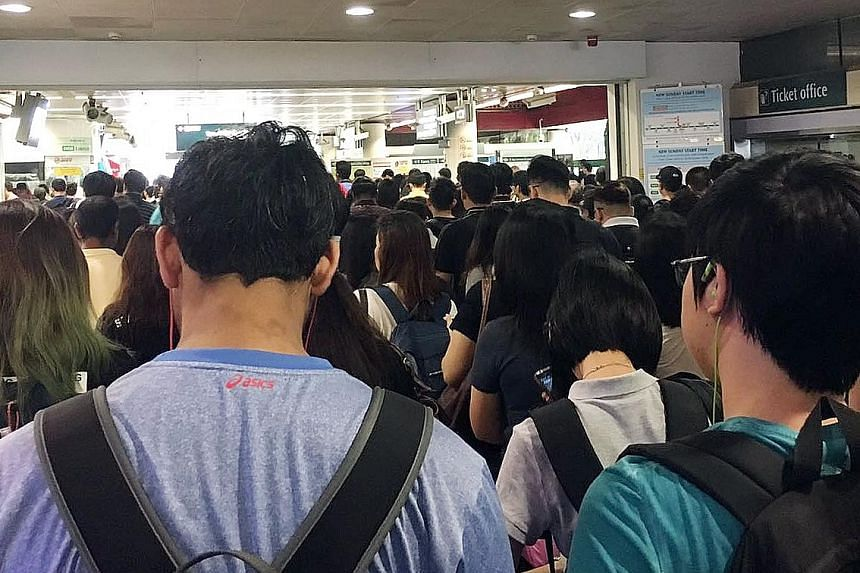 Commuters crowd Lakeside MRT Station after train journeys on the East-West MRT Line were delayed during the morning peak period on Oct 21 last year.