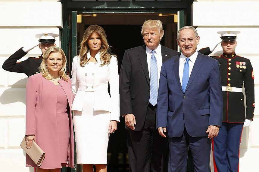 US President Donald Trump and First Lady Melania Trump (centre) with Israeli Prime Minister Benjamin Netanyahu and his wife Sara at the South Portico of the White House in Washington on Wednesday. Mr Trump said he would be happy with either a two-sta
