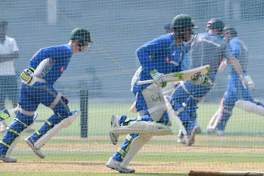 Australia's Test cricket captain Steve Smith (left) and teammate Usman Khawaja running as they bat in the nets during a training session at The Brabourne Cricket Stadium in Mumbai, on Feb 15, 2017.
