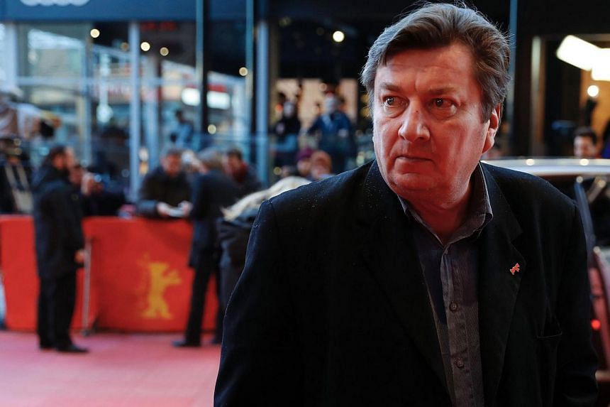 Finnish director and screenwriter Aki Kaurismaki arrives on the red carpet for the premiere of the film The Other Side of Hope in competition at the 67th Berlinale film festival in Berlin.