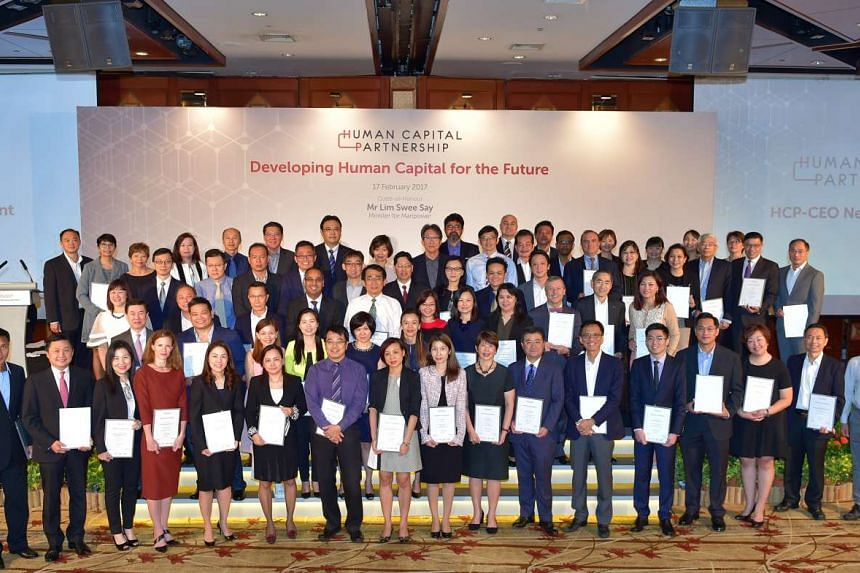 Minister for Manpower Lim Swee Say with the pioneer batch of about 70 Human Capital Partners recognised for their commitment in human capital development and adopting progressive workplace practices.