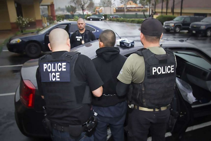 US immigration officers detain a suspect during an enforcement operation on Feb 7, 2017, in Los Angeles.