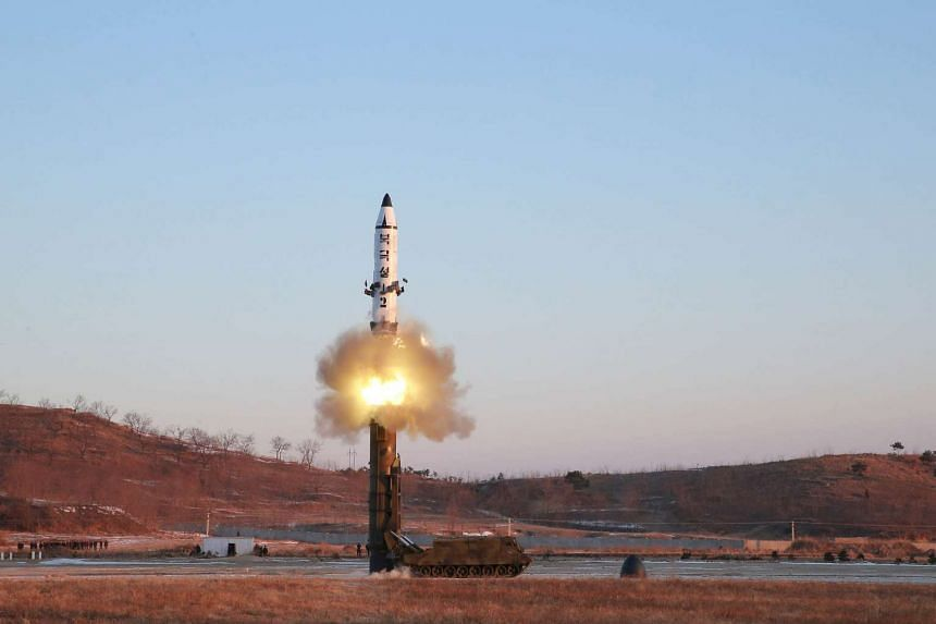 A view of the test-fire of the Pukguksong-2 guided by North Korean leader Kim Jong Un on the spot, in an undated photo released Feb 13, 2017.