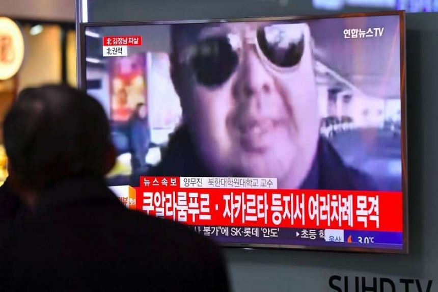 A man watches a TV showing news reports of Kim Jong-Nam in Seoul on Feb 14, 2017.