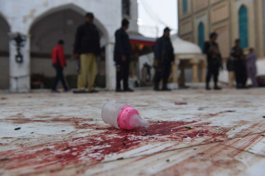 A baby feeder lies on the blood-stained floor at the 13th century Muslim Sufi shrine.