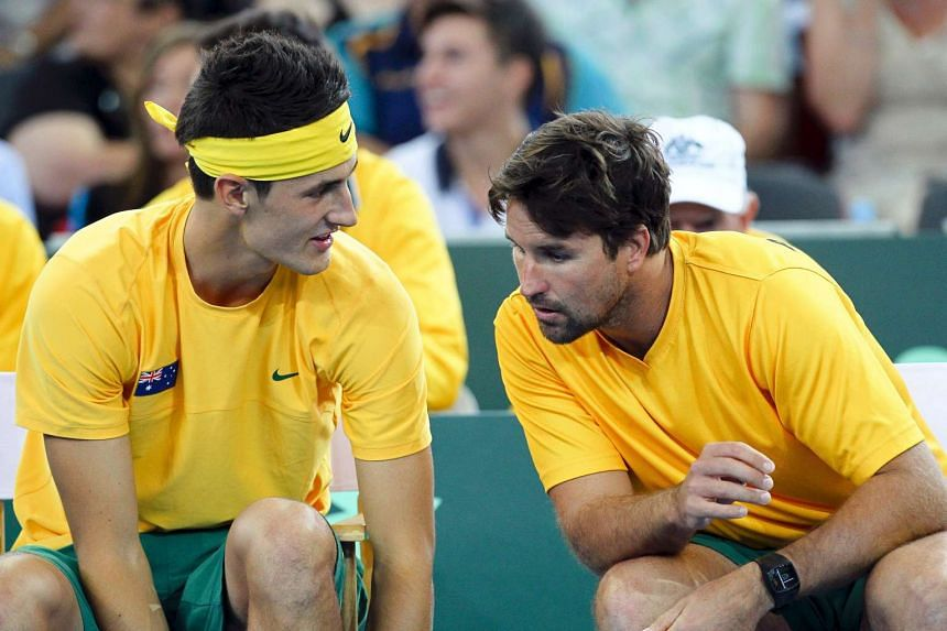 File photo of Bernard Tomic (left) of Australia talking with coach Pat Rafter during his men's singles Davis Cup tennis match against Cho Min Hyeok of South Korea in Brisbane.