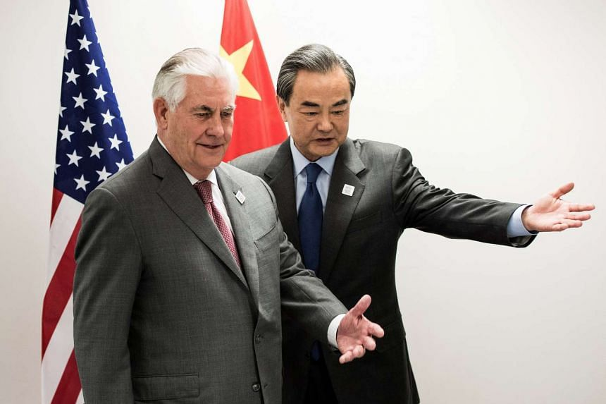 US Secretary of State Rex Tillerson (left) and China's Foreign Minister Wang Yi at a Group of 20 nations (G-20) gathering of foreign ministers in Bonn, Germany, on Feb 17, 2017.