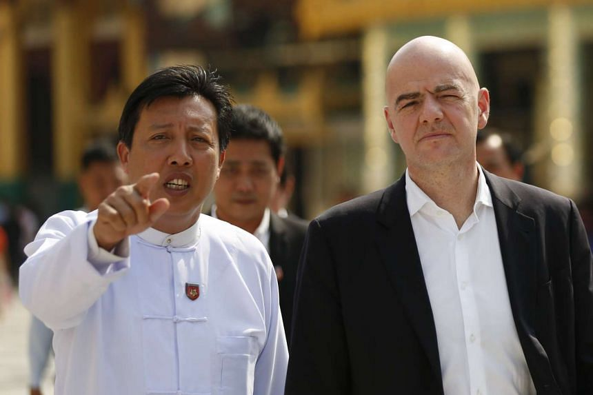 Fifa president Gianni Infantino (right) and Myanmar Football Federation president Zaw Zaw converse during a visit to the Shwedagon pagoda in Yangon, Feb 17, 2017.