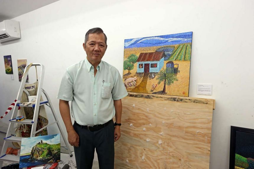 Mr Tan Choon Heng, 54, with his artwork, titled My Home From The Past.
