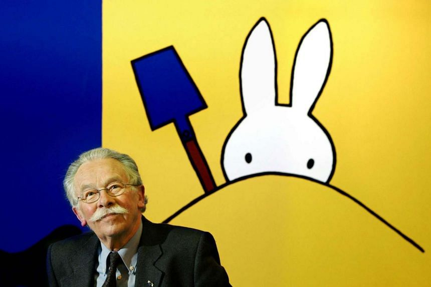 """Illustrator Dick Bruna posing at the opening of his exhibition """"Miffy creations"""" in Madurodam, The Hague in 2005."""