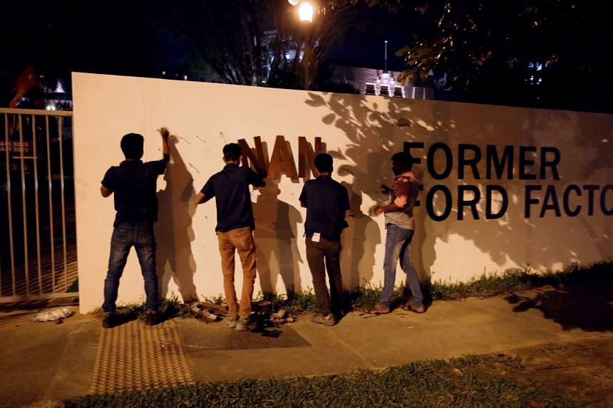 Workers removing the sign from the entrance of the gallery on Friday night (Feb 17).