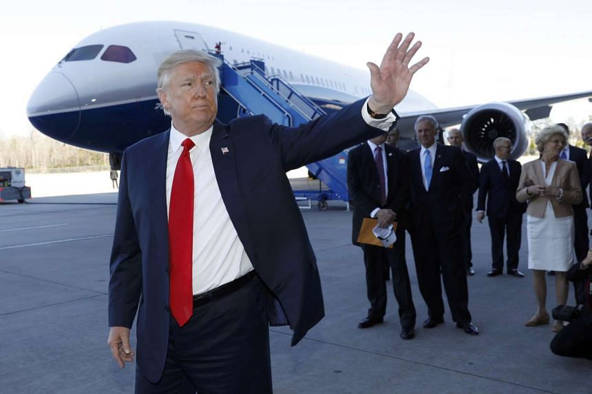 Trump waves after speaking at a Boeing event in North Charleston, South Carolina, Feb 17, 2017.
