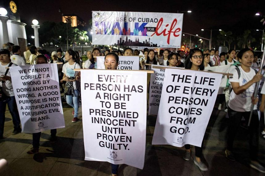"""Saturday's event, called the """"Walk for Life"""", gathered 20,000 people, according to the organisers. Manila police estimated the crowd at 10,000."""