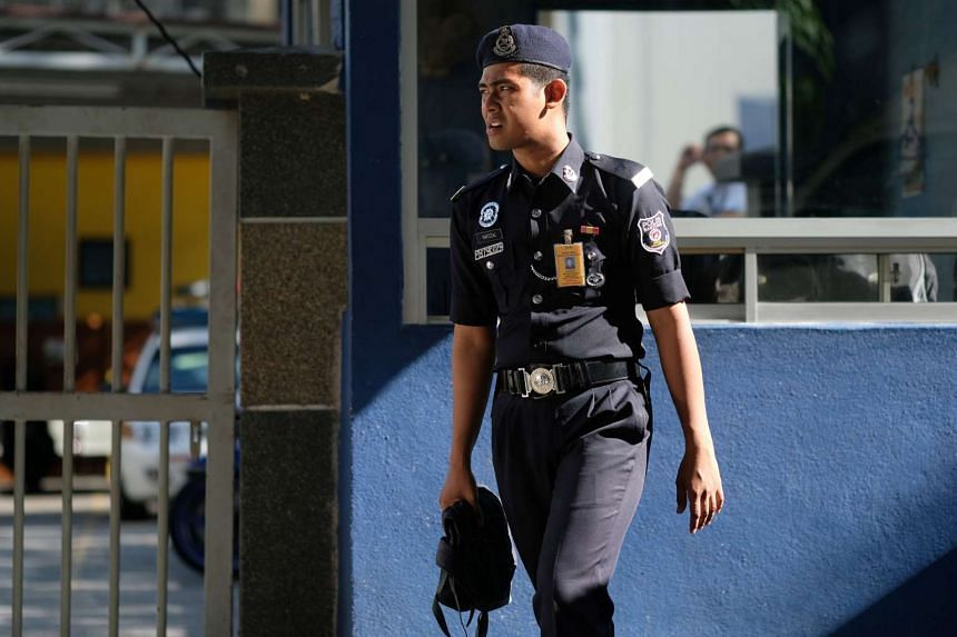 A police officer stands outside the morgue at Kuala Lumpur General Hospital where Kim Jong Nam's body is held for autopsy in Malaysia on Feb 18, 2017.