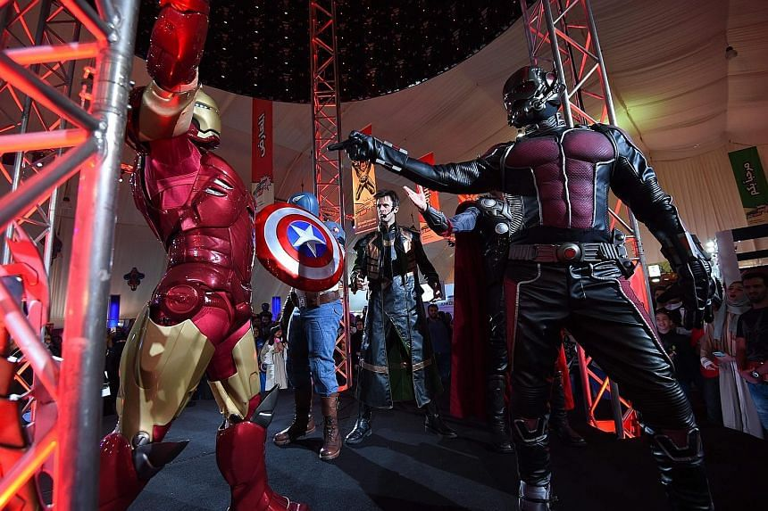 People dressed as Marvel's Avengers performing at Saudi Arabia's first Comic-Con event in Jeddah.