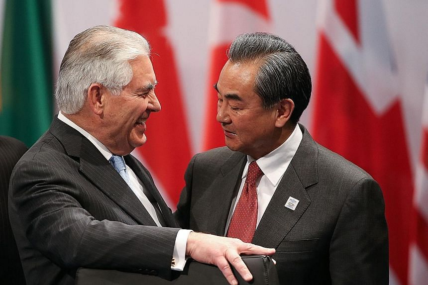 Mr Tillerson and Mr Wang at the Group of 20 foreign ministers' meeting in Bonn, Germany, on Thursday. Their meeting yesterday was the highest-level Sino-US encounter since President Trump was elected.