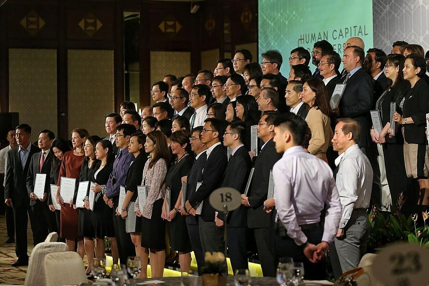 Company representatives receiving the Human Capital Partnership symbol, signifying their firms as progressive employers who develop staff, yesterday.