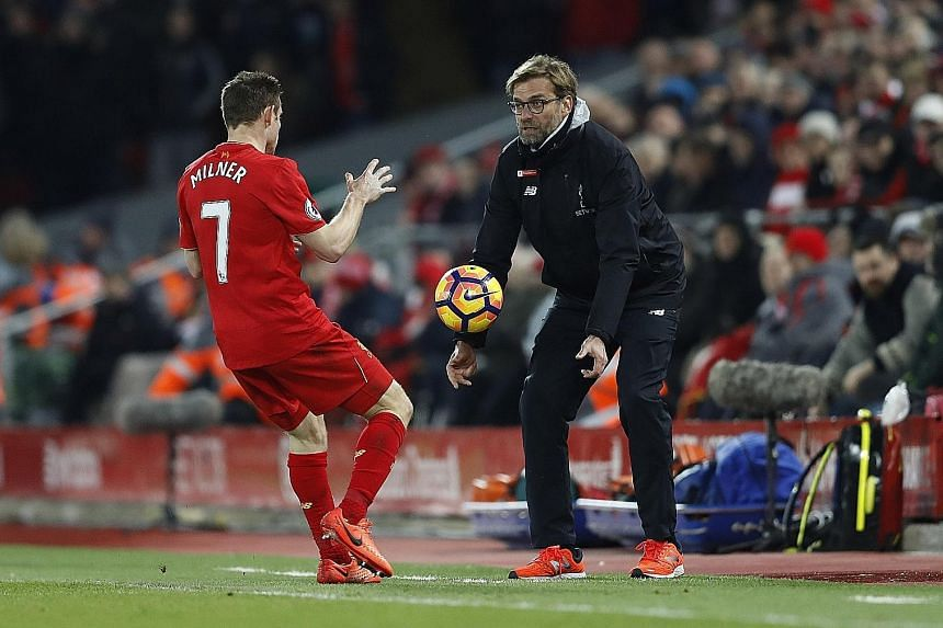 Liverpool manager Jurgen Klopp geeing up James Milner during last weekend's win over Tottenham, their first in the Premier League this year. The German said his side will learn lessons from their winless run.