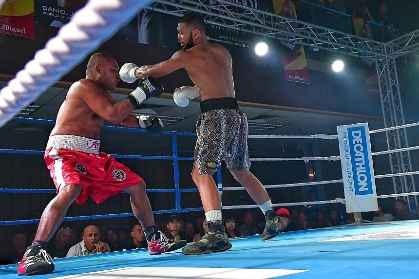 Rafi Majid connecting with a left hook to put Thai Plaisakda Boonmalert on the ropes. The Singaporean took just 1min 47sec to win the UBO super middleweight Asia-Pacific title.