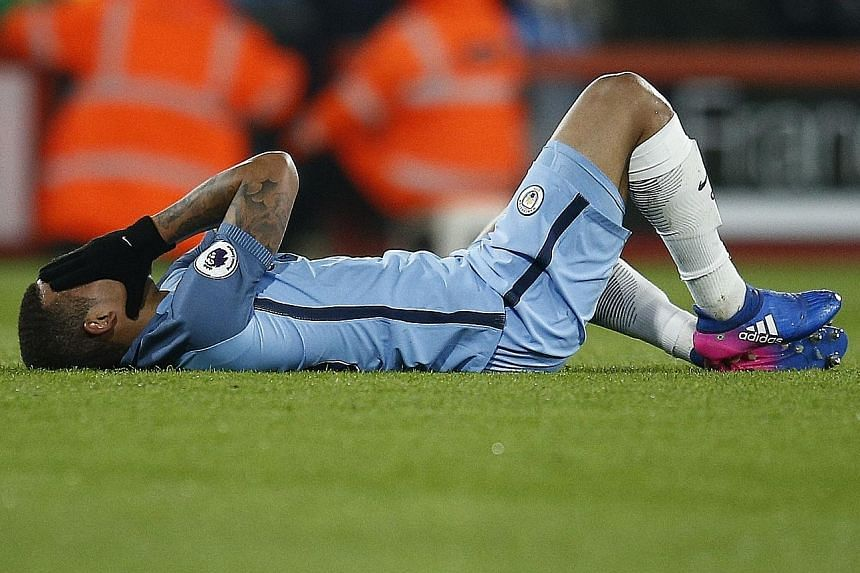 City's Gabriel Jesus lying on the ground after breaking a bone in his foot against Bournemouth. He could take two to three months to recover.