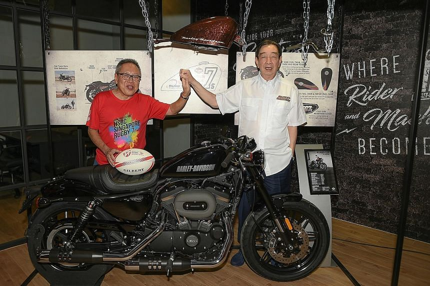 Rugby Singapore chairman Low Teo Ping (left) and Komoco Motorcycles managing director Teo Hock Seng, friends for 53 years, with a Harley- Davidson Roadster worth $39,000 that one Singapore 7s ticket holder will win.