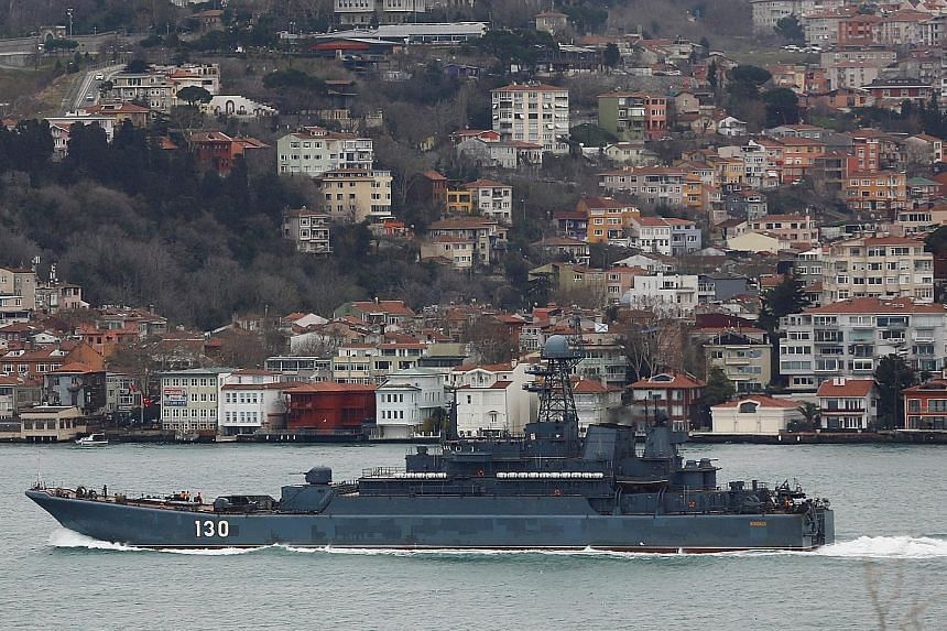 A Russian Navy ship on the Bosphorus Strait heads towards the Black Sea. A Nato official said Nato's move to bolster its naval presence in the Black Sea was to counter Russia's military build-up there.
