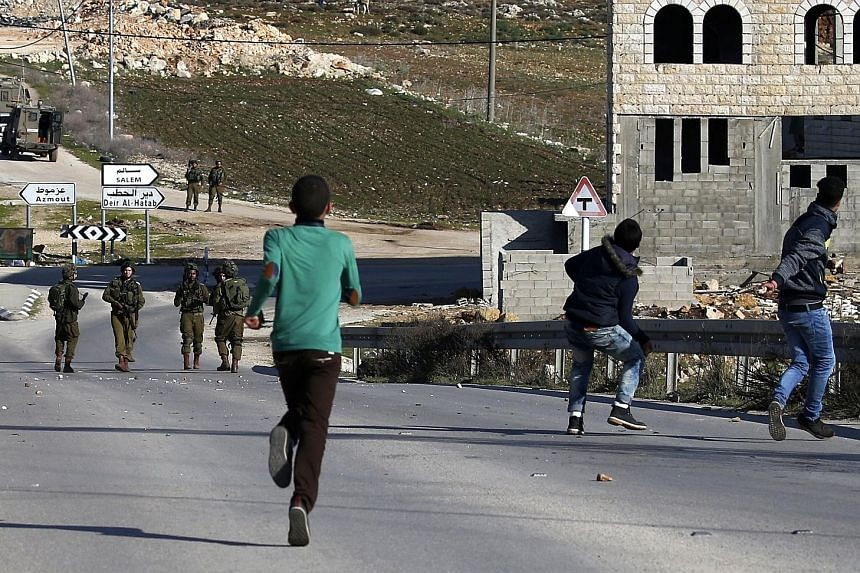 Israeli soldiers and stone-throwing Palestinians clashing in the east of Nablus in the West Bank earlier this month.
