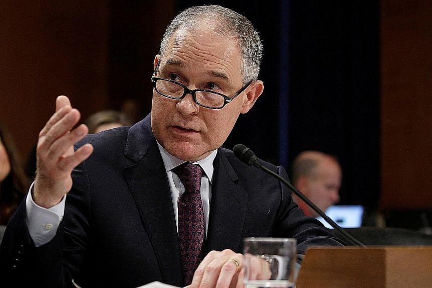 Mr Trump's choice of Mr Pruitt (above, left) to head EPA is controversial, while his choice of Mr Acosta (above, right) for secretary of labour is seen as safe.