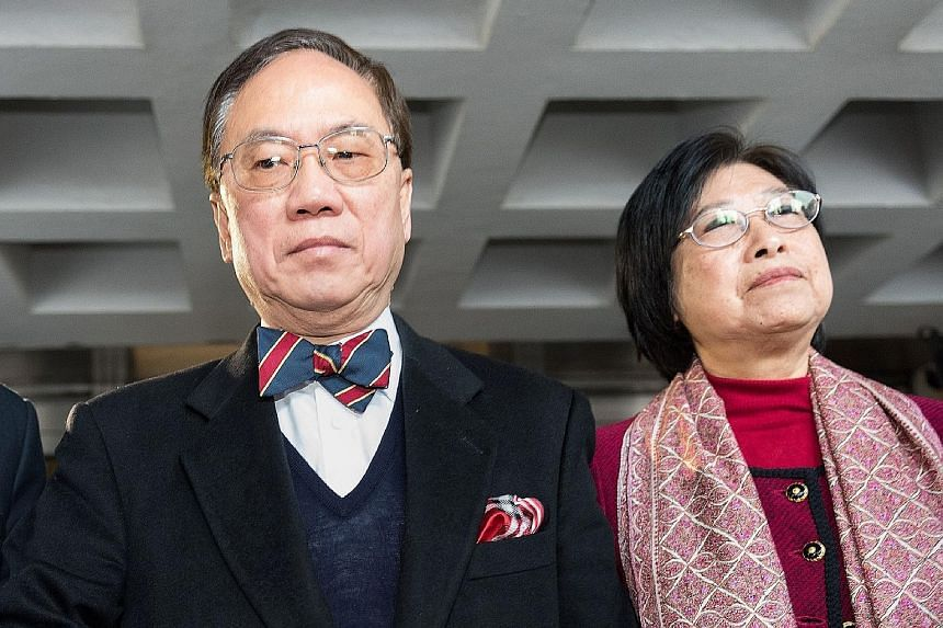 Tsang, seen here with his wife Selina, is the highest-ranking former official to be charged in Hong Kong's history. The jury found him not guilty of a second misconduct charge and failed to reach a majority decision on a bribery charge.