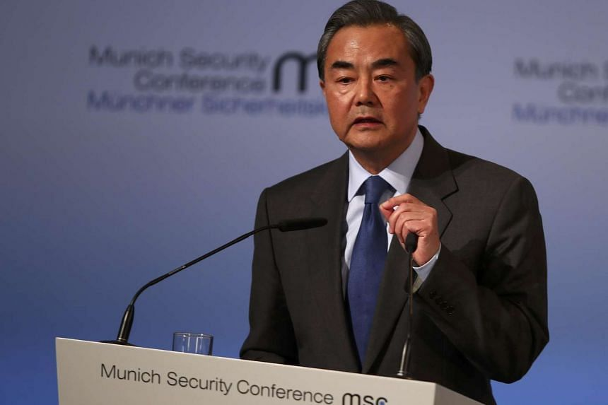 Chinese Foreign Minister Wang Yi speaking at the 53rd Munich Security Conference in Munich, Germany, on Feb 17, 2017. He told his Japanese counterpart Fumio Kishida that both countries should make efforts to bring bilateral ties back onto the right t