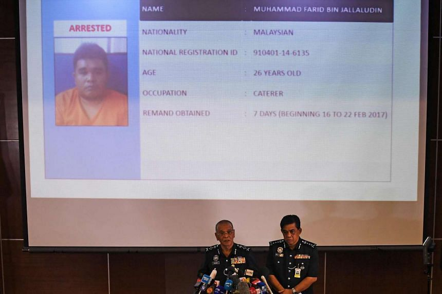 Royal Malaysian Police deputy inspector-general Noor Rashid Ibrahim (centre, left) speaks about detained Malaysian suspect Muhammad Farid Bin Jalaluddin (top) during a press conference at the Bukit Aman national police headquarters in Kuala Lumpur on