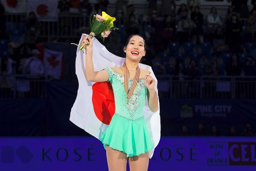 Mai Mihara of Japan celebrates during the awards ceremony after the ladies free skating event of the ISU Four Continents Figure Skating Championships at Gangneung Ice Arena in South Korea on Feb 18, 2017.