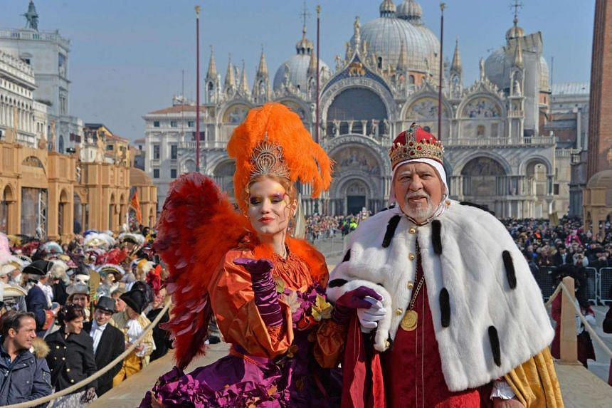 Ms Claudia Marchiori, winner of last year's 'Maria of the Carnival' contest, posing with the Doge after performing the Flight of the Angel, at the Venice Carnival on Feb 19, 2017.