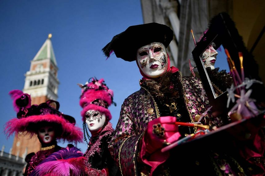 Revellers dressed in masks and period costumes taking part in the Venice Carnival on Feb 19, 2017.