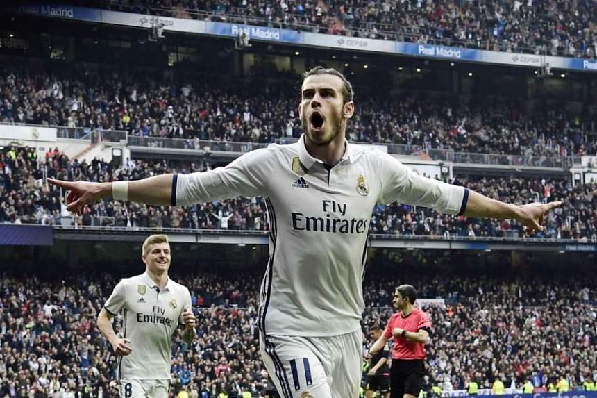 Real Madrid's Welsh forward Gareth Bale celebrates scoring.