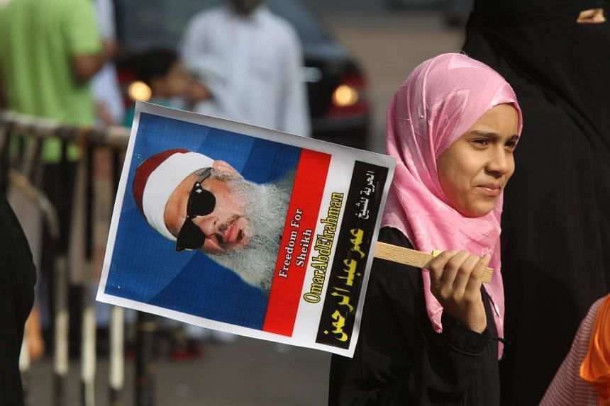 A 2011 photo shows an Egyptian girl holding a portrait of cleric Sheikh Omar Abdel Rahman during a sit-in to call for his release in front of the US Embassy in Cairo.