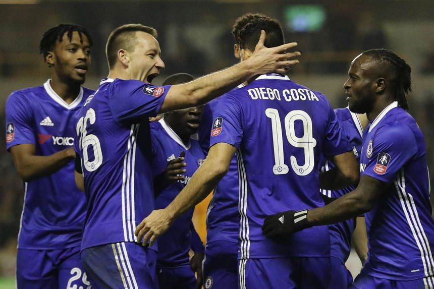 Chelsea's Diego Costa celebrates scoring their second goal with John Terry.