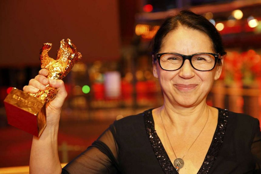 Director Ildiko Enyedi receives the Golden Bear for Best Film On Body And Soul.