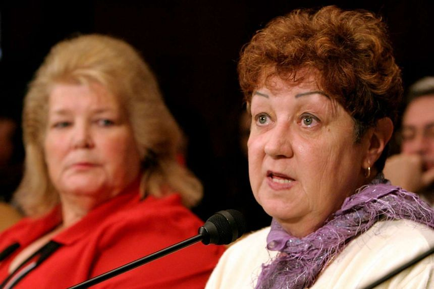 Norma McCorvey (right) is pictured in 2005 testifying before the Senate Judiciary Committee in Washington.
