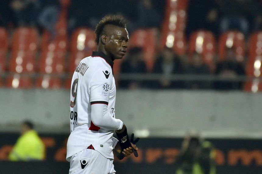 Nice's Italian forward Mario Balotelli leaves the field after receiving a red card during their French L1 football match against Lorient on Feb 18, 2017.