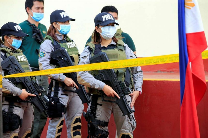 Philippine Drug Enforcement Agency operative stand on guard during the destruction of confiscated illegal drugs in Trece Martires town in Cavite city, Philippines on Feb 16, 2017.